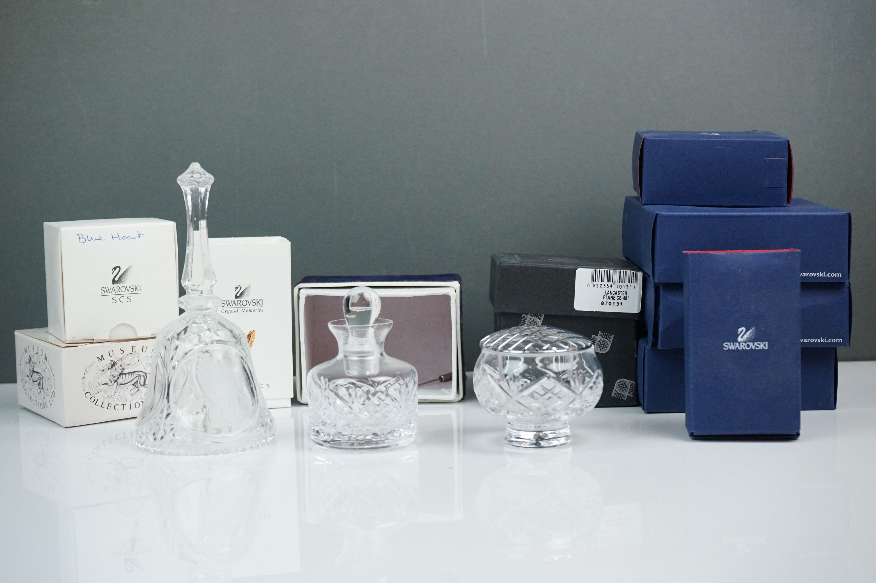 A collection of Swarovski crystal collectables to include Bell, rose vase, inkwell.etc.