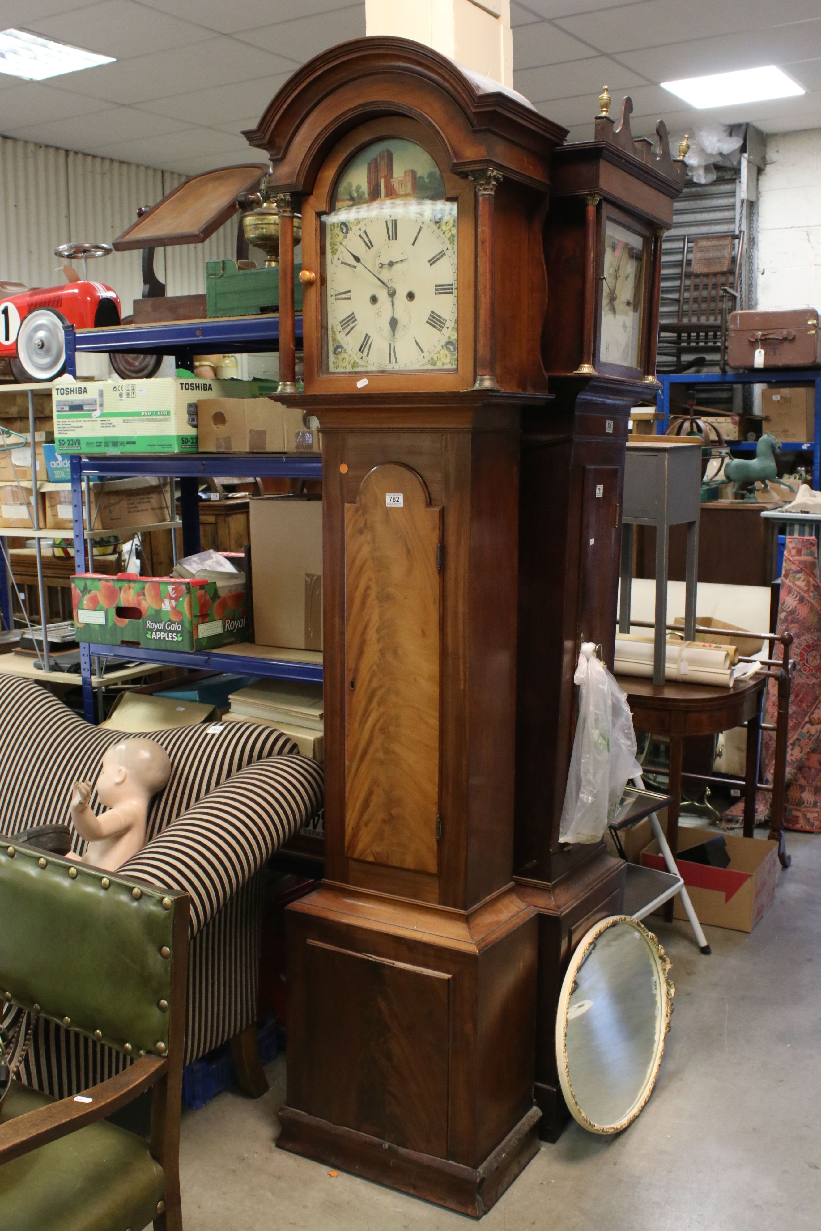 19th century Mahogany 8 day Longcase Clock, the arched dial painted with the scene of a Folly, the