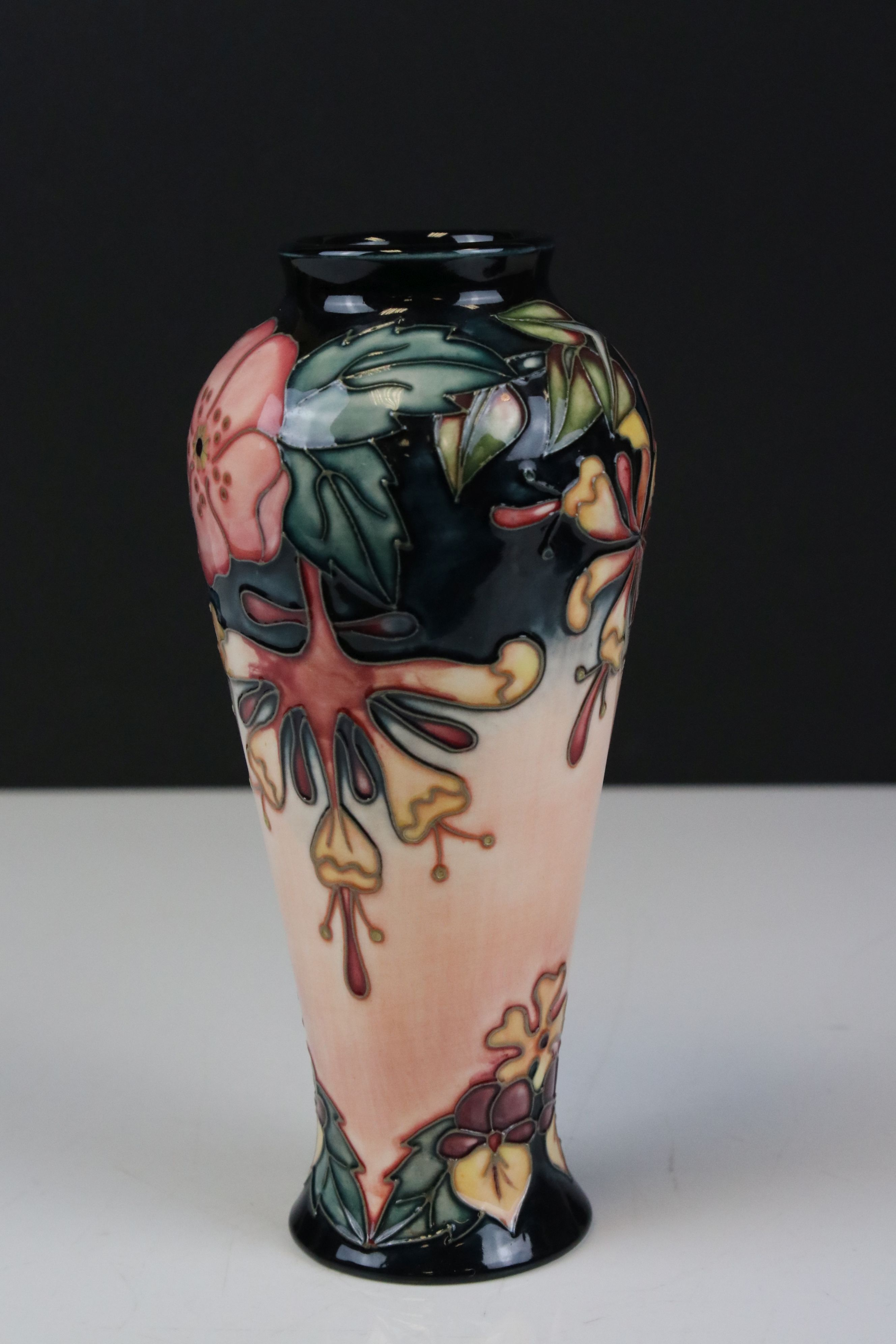 Moorcroft Vase in the Oberon pattern, impressed pink marks to base and signed WM, 21cms high