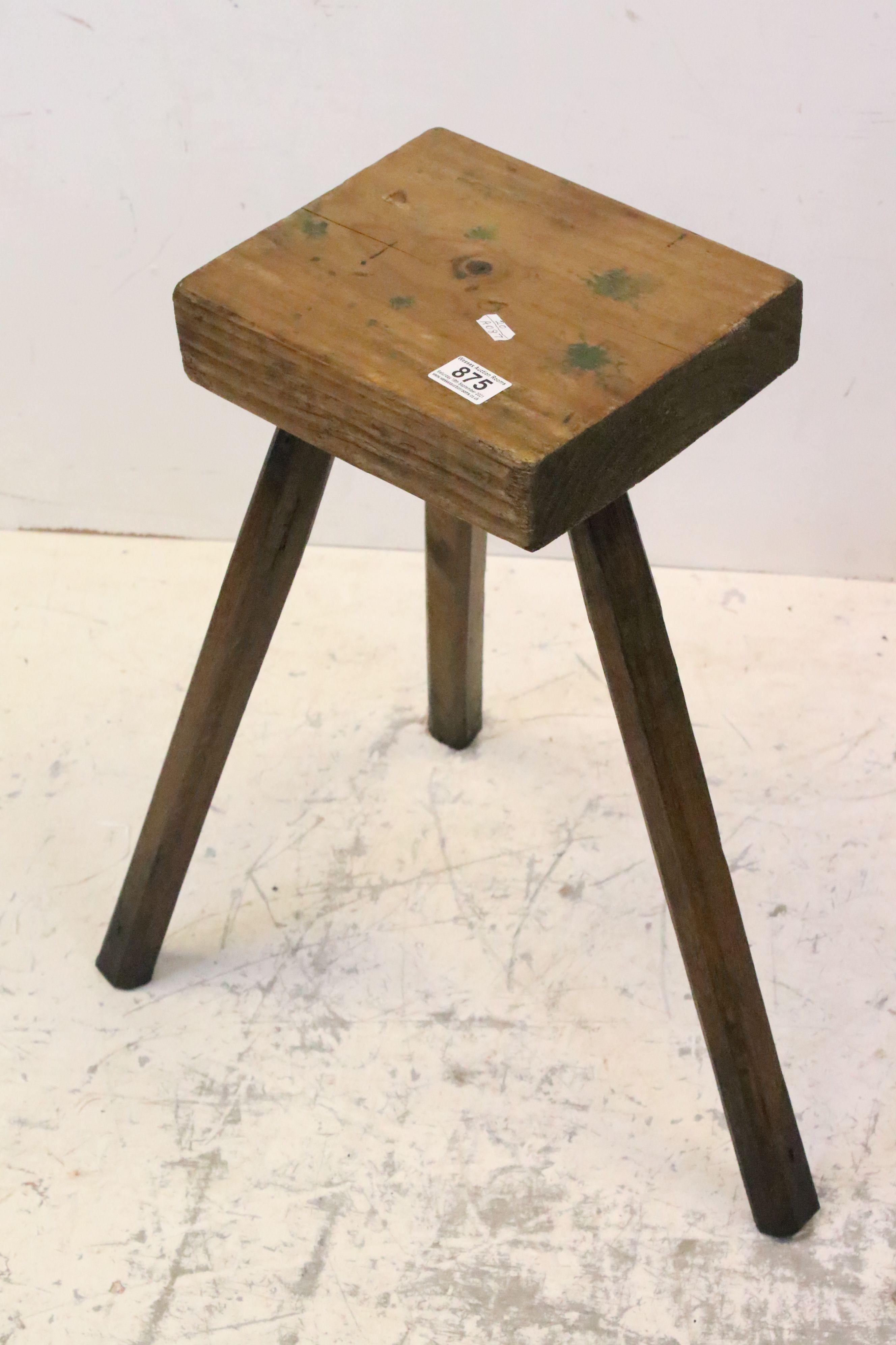 Antique game preparation table stool on three legs
