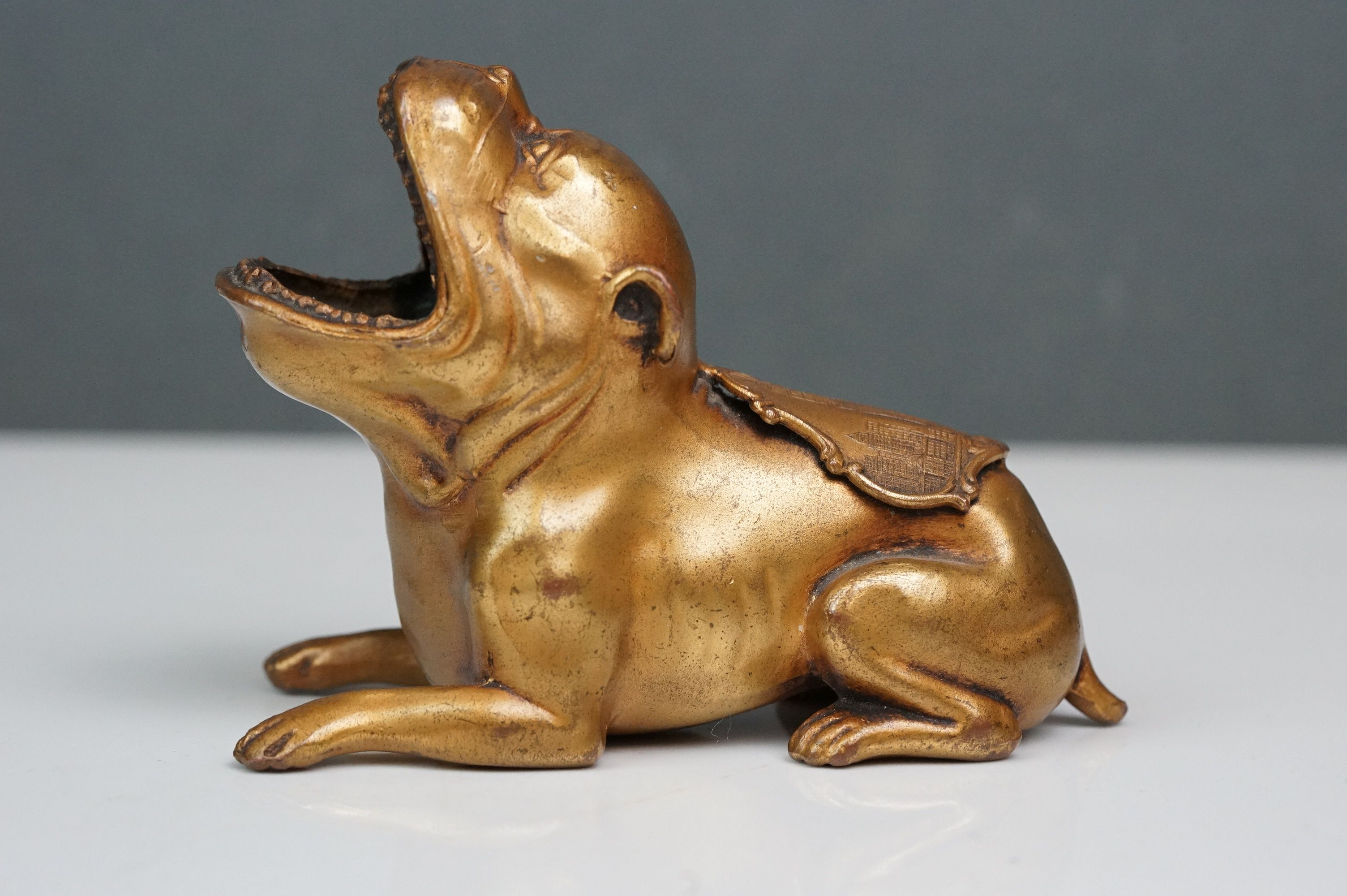Woolworth Building New York paperweight in the form of a dog with mouth open and Woolworth Buildings