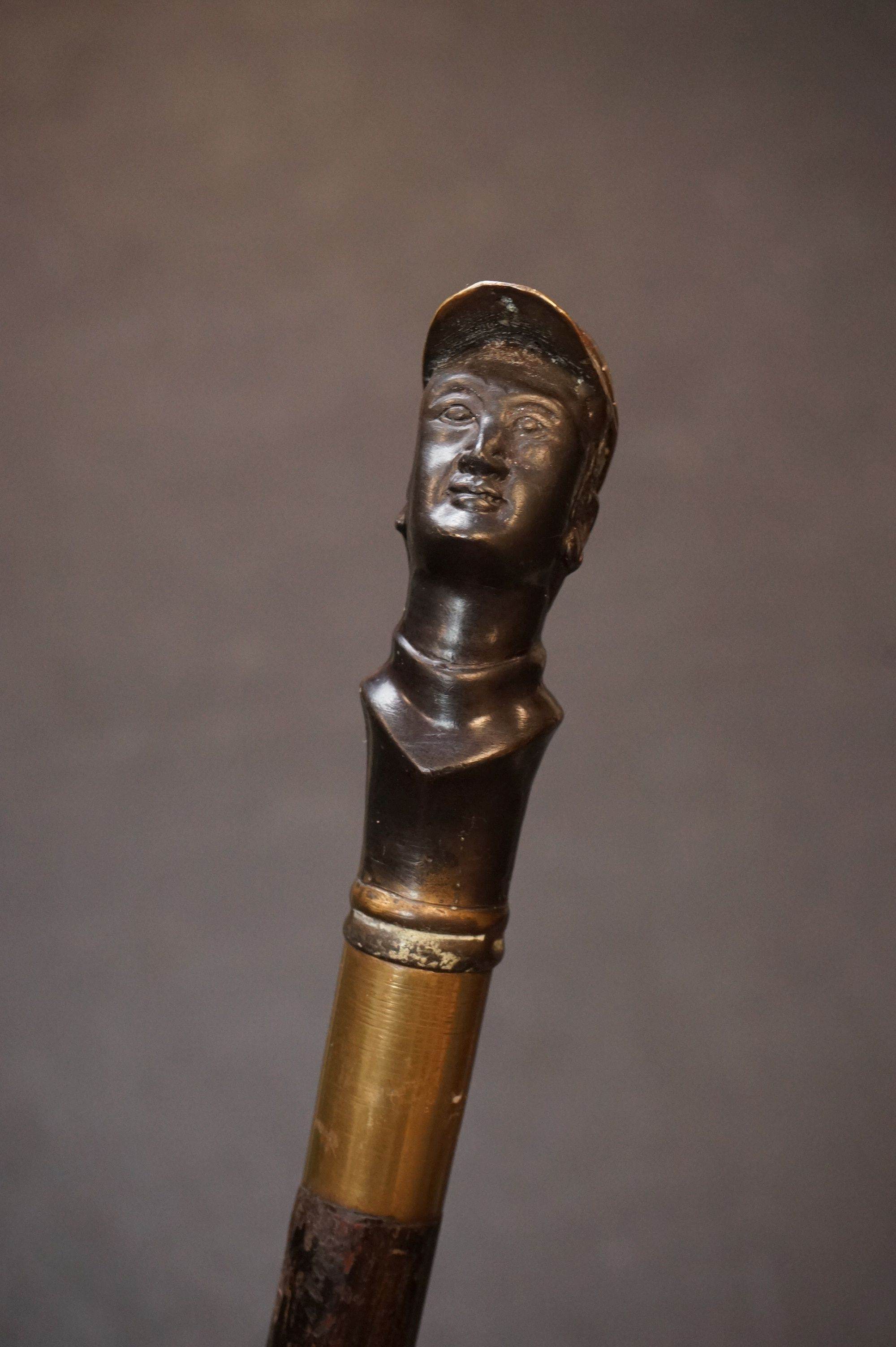 A wooden walking stick with bronzed mounted head of a jockey to the finial, possibly Fred Archer. - Image 2 of 7