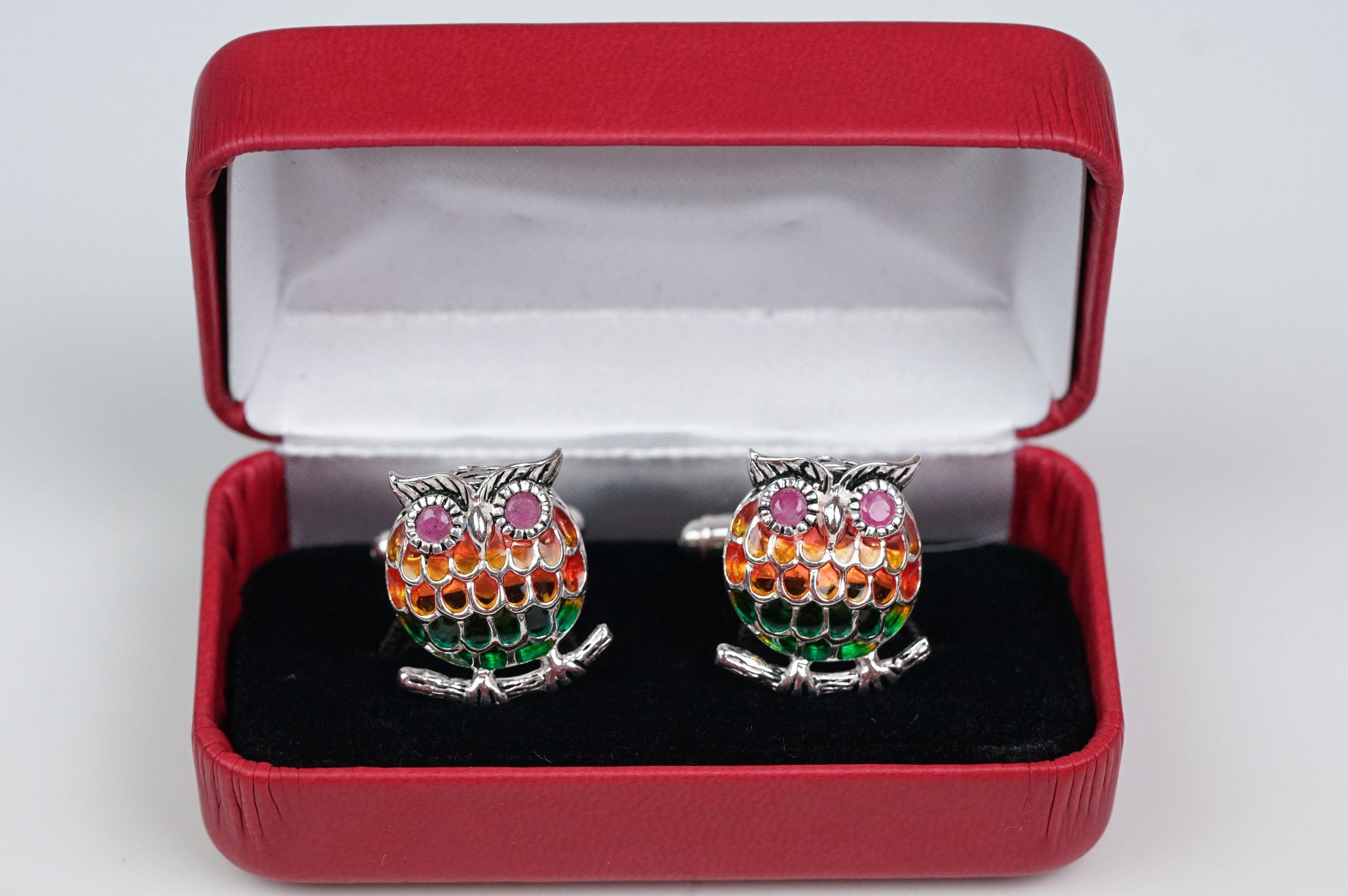 Pair of silver plique-a-jour owl cufflinks, set with ruby eyes