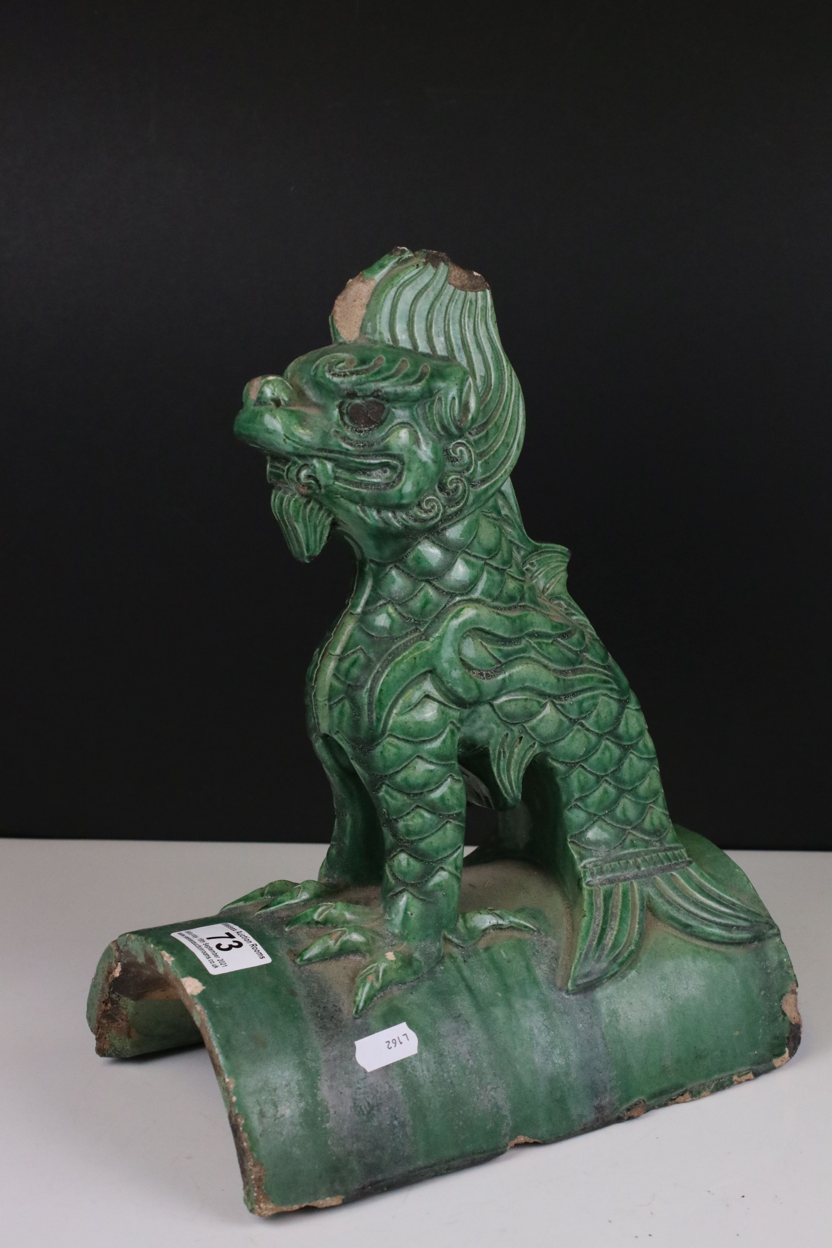 Chinese Green Glazed Pottery Roof Ridge Tile surmounted by a Mythical Creature, 34cms high