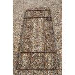 A vintage wrought iron Garden gate.