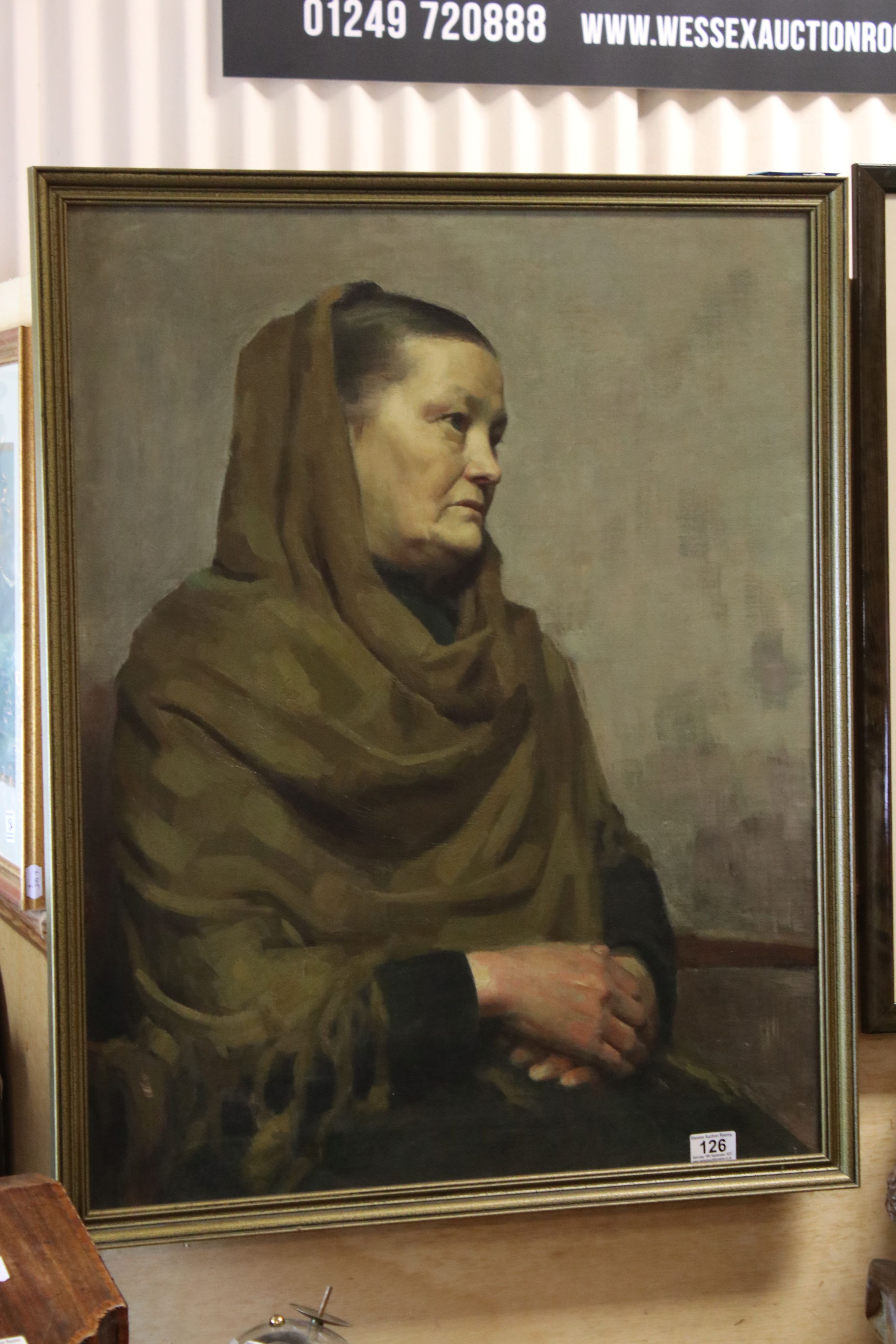 Late 19th / Early 20th century Oil on Canvas Half-portrait of a Seated Woman wearing a green