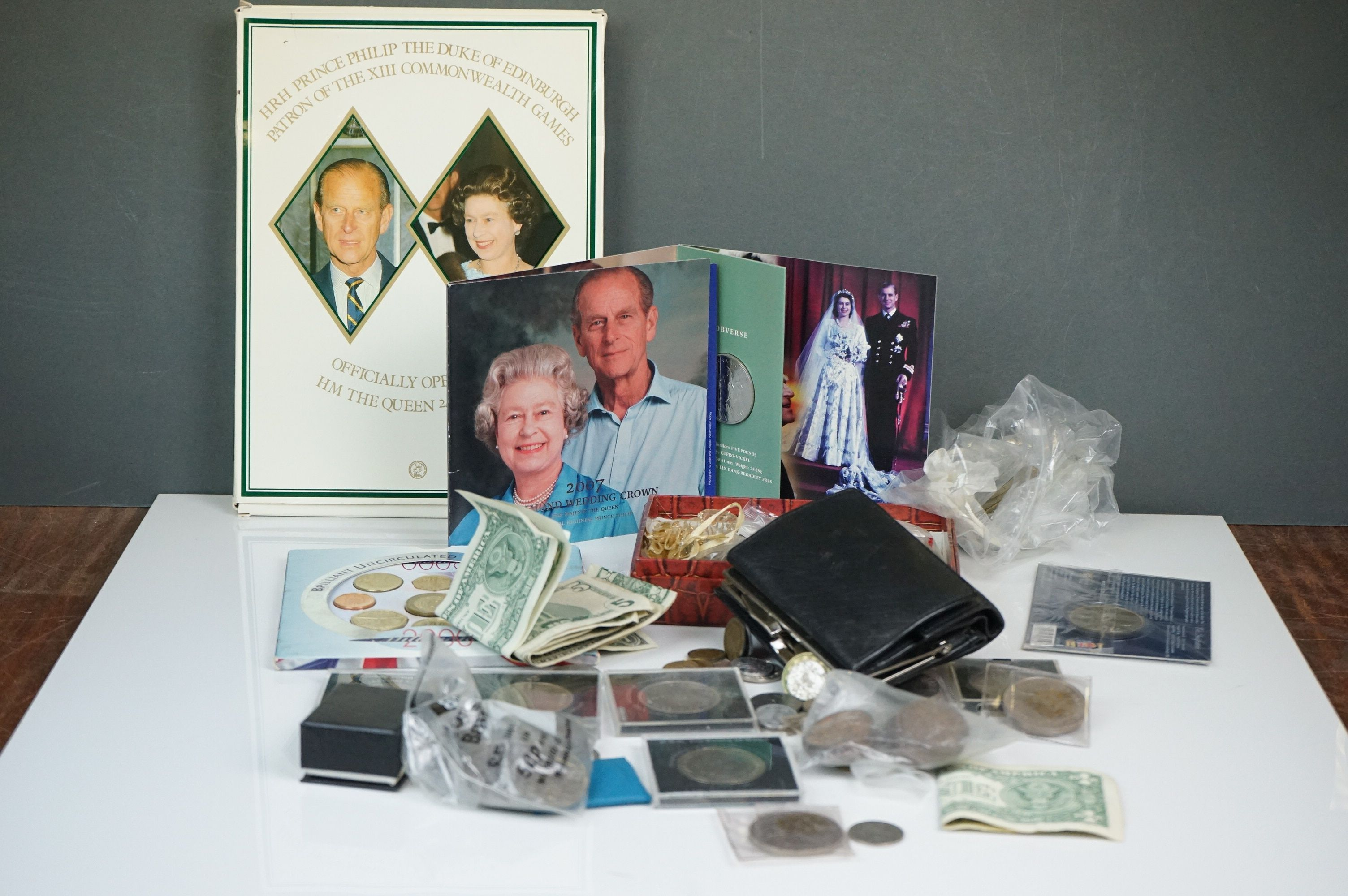 A collection of British and world coins to include commemorative and proof examples