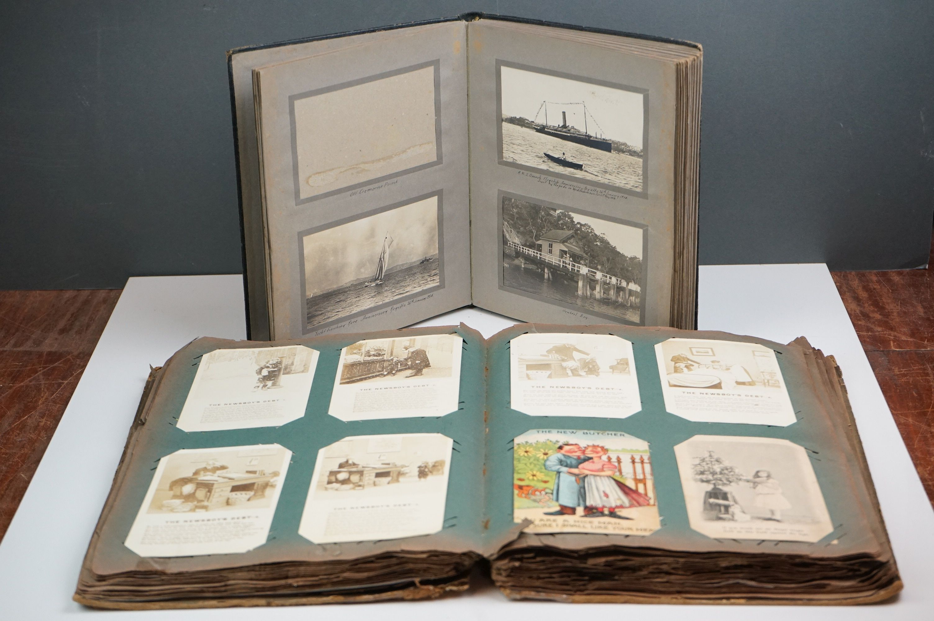 A large collection of early 20th century postcards contained within an album, mainly printed