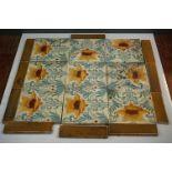 A collection of antique Art Nouveau Minton tiles.