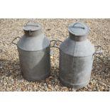 A pair of vintage galvanised milk churns.