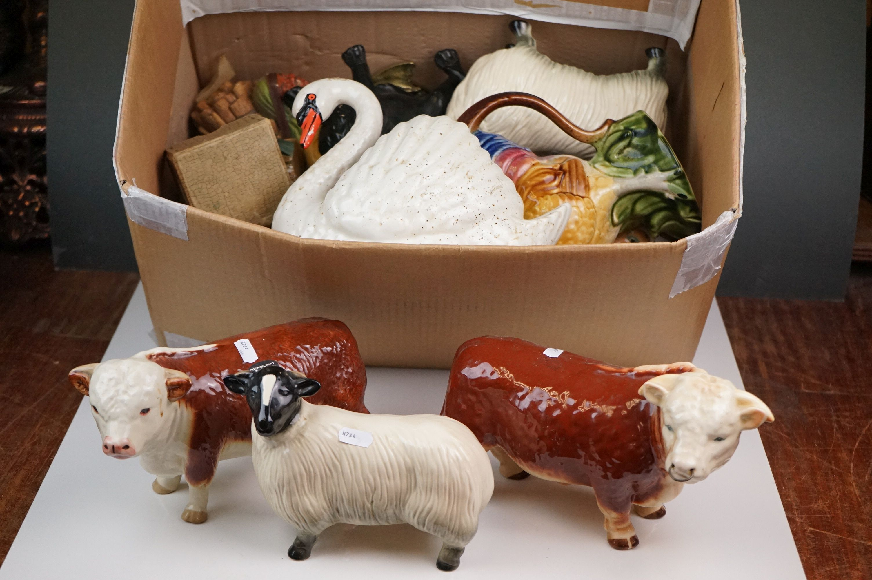 A group of mixed ceramics to include wade and cooper craft animals.