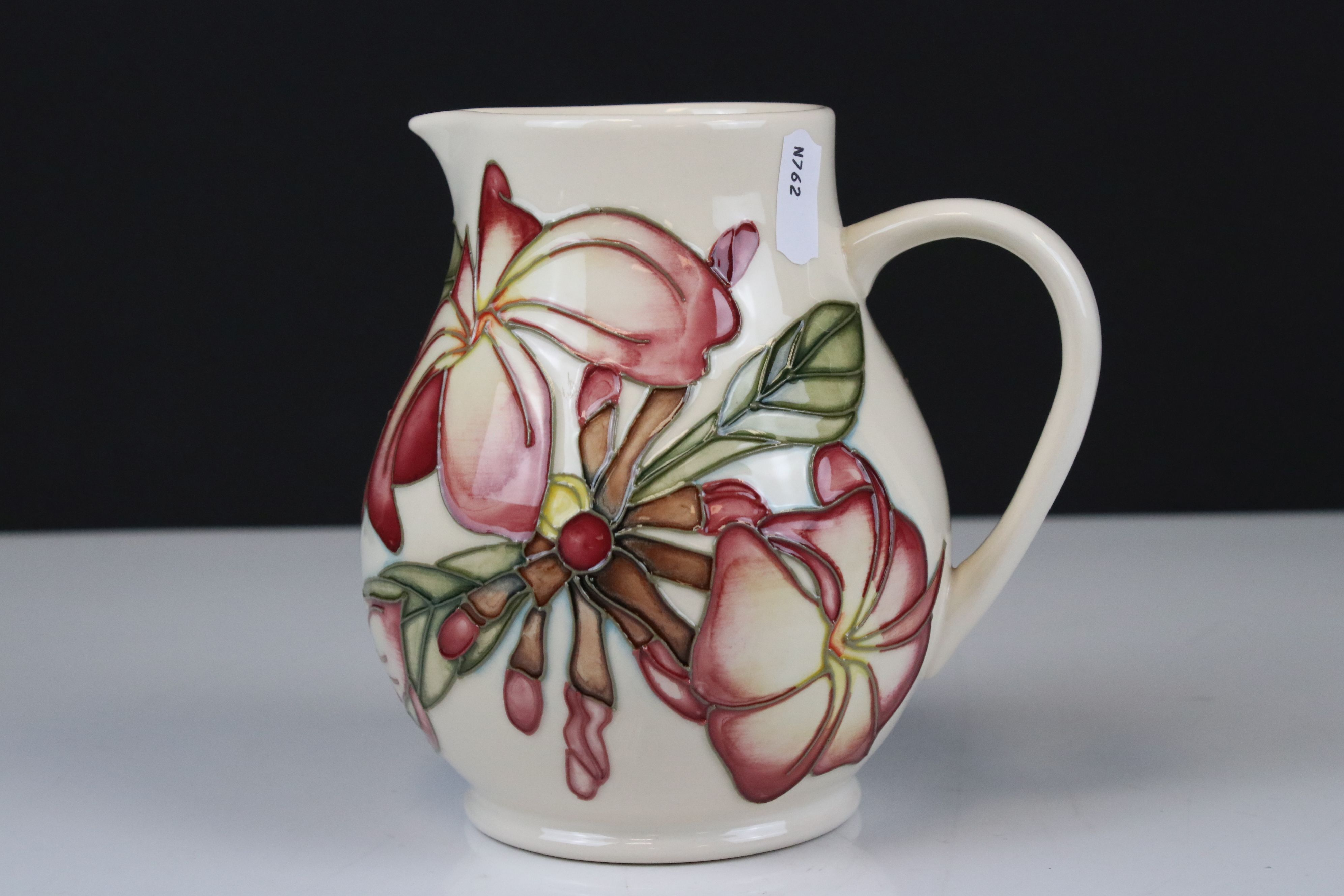 Moorcroft Jug in the Frangipani Plumeria pattern on a white ground, 15cms high - Image 2 of 4