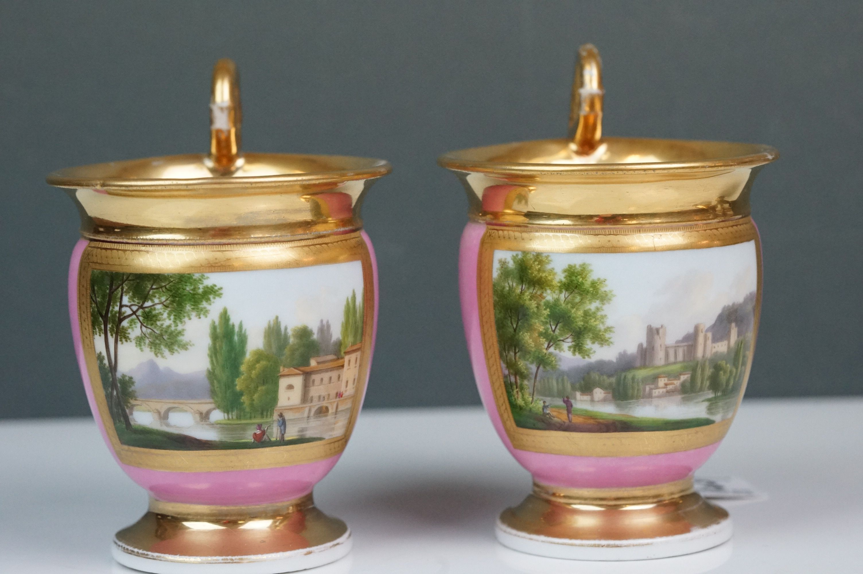 Pair of hand painted Dresden cups, each depicting a different scene: castle and lake scene with - Image 5 of 10