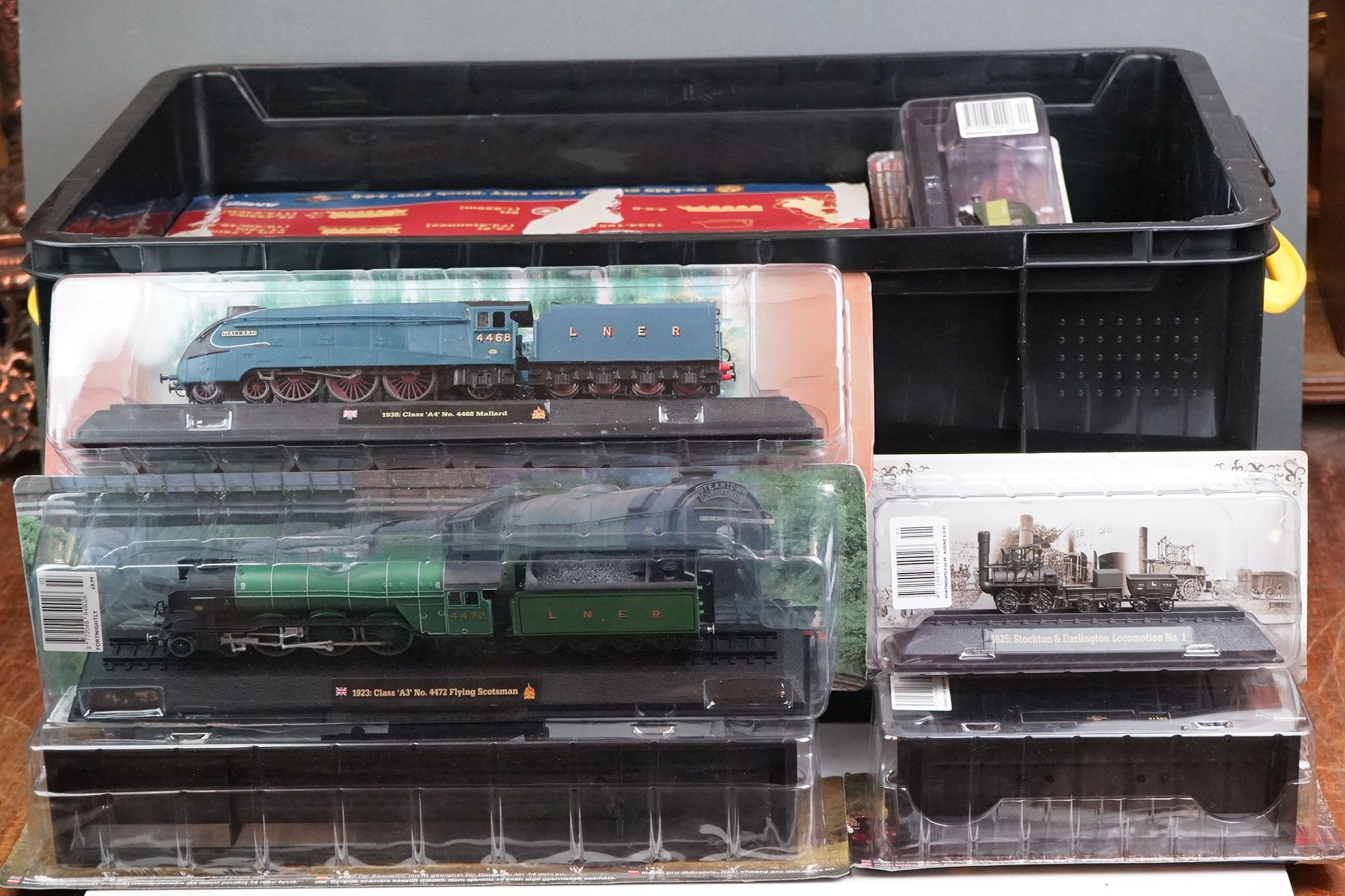A large collection of railway locomotive models contained within three boxes to include the 1963