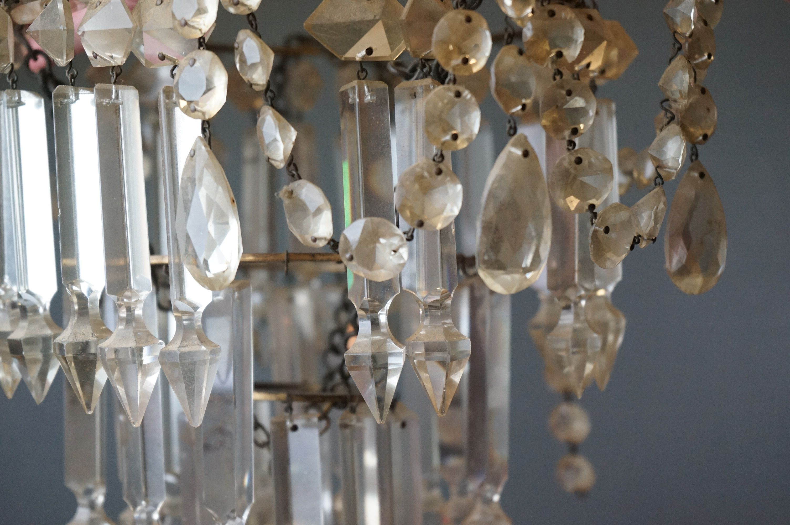 A antique three tier chandelier with glass droplets. - Image 2 of 4