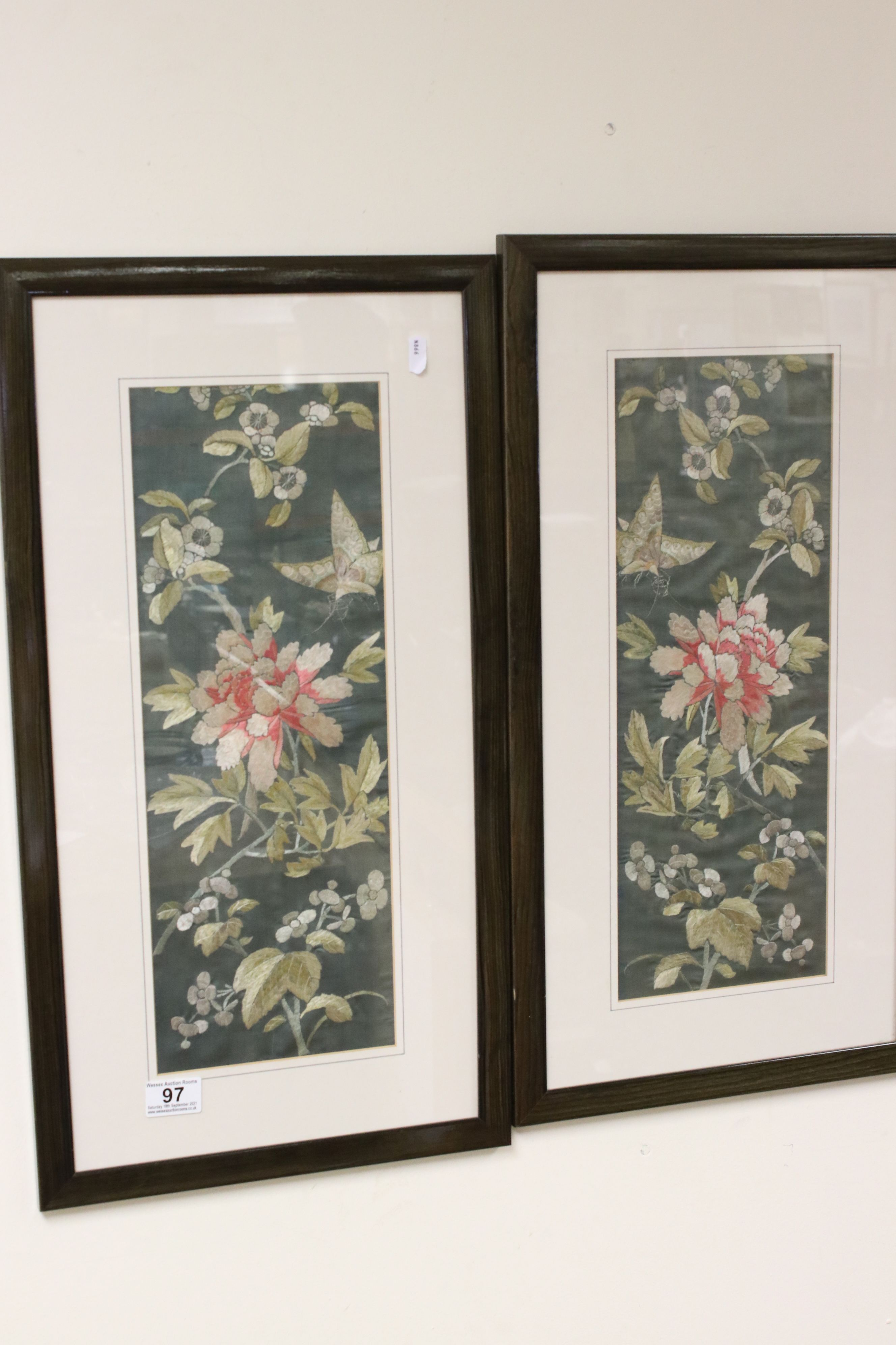 Pair of Framed and Glazed Oriental Silk Embroideries on a Green Ground depicting Butterflies and