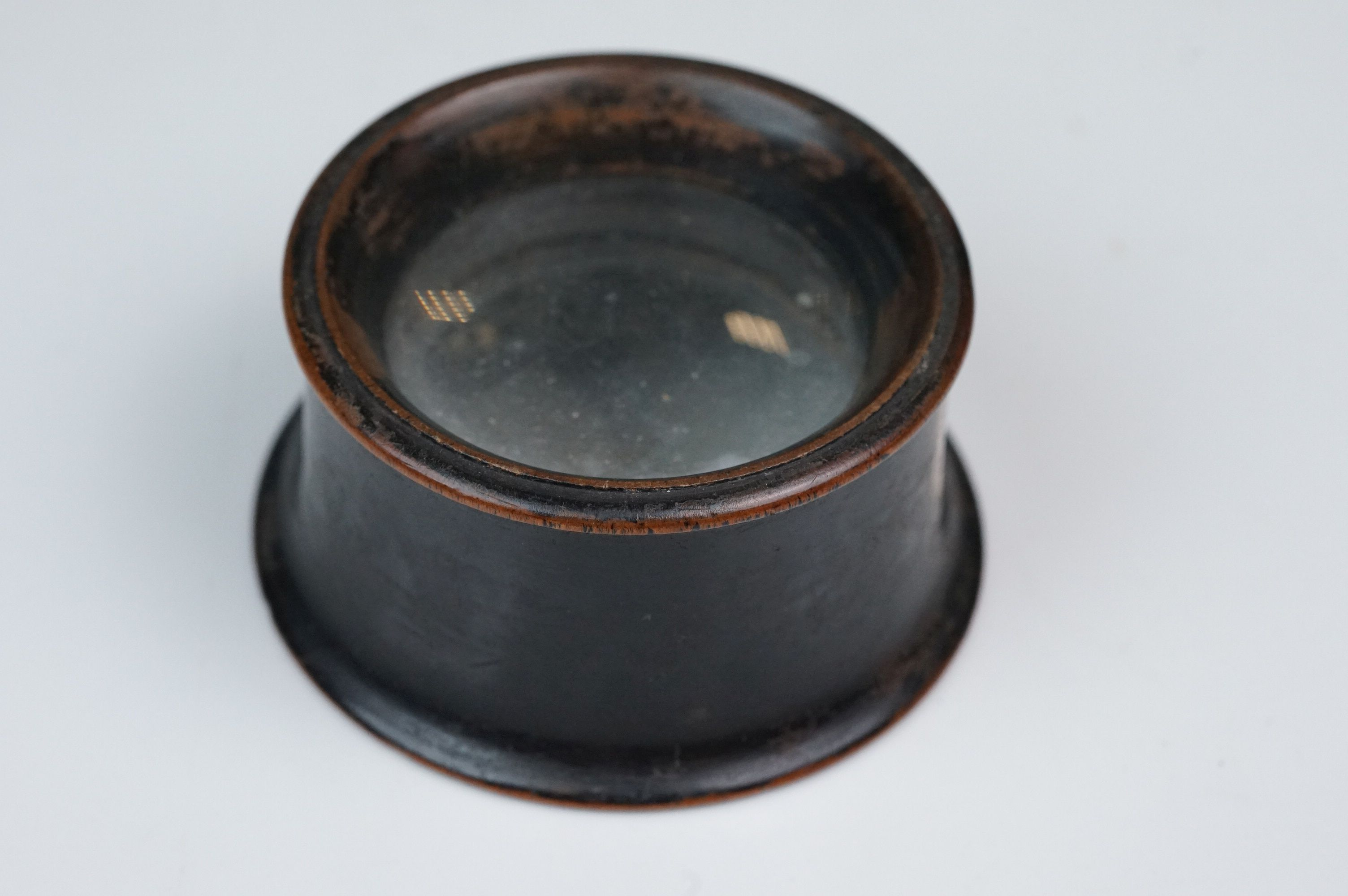 A 19th century wooden magnifying loupe.