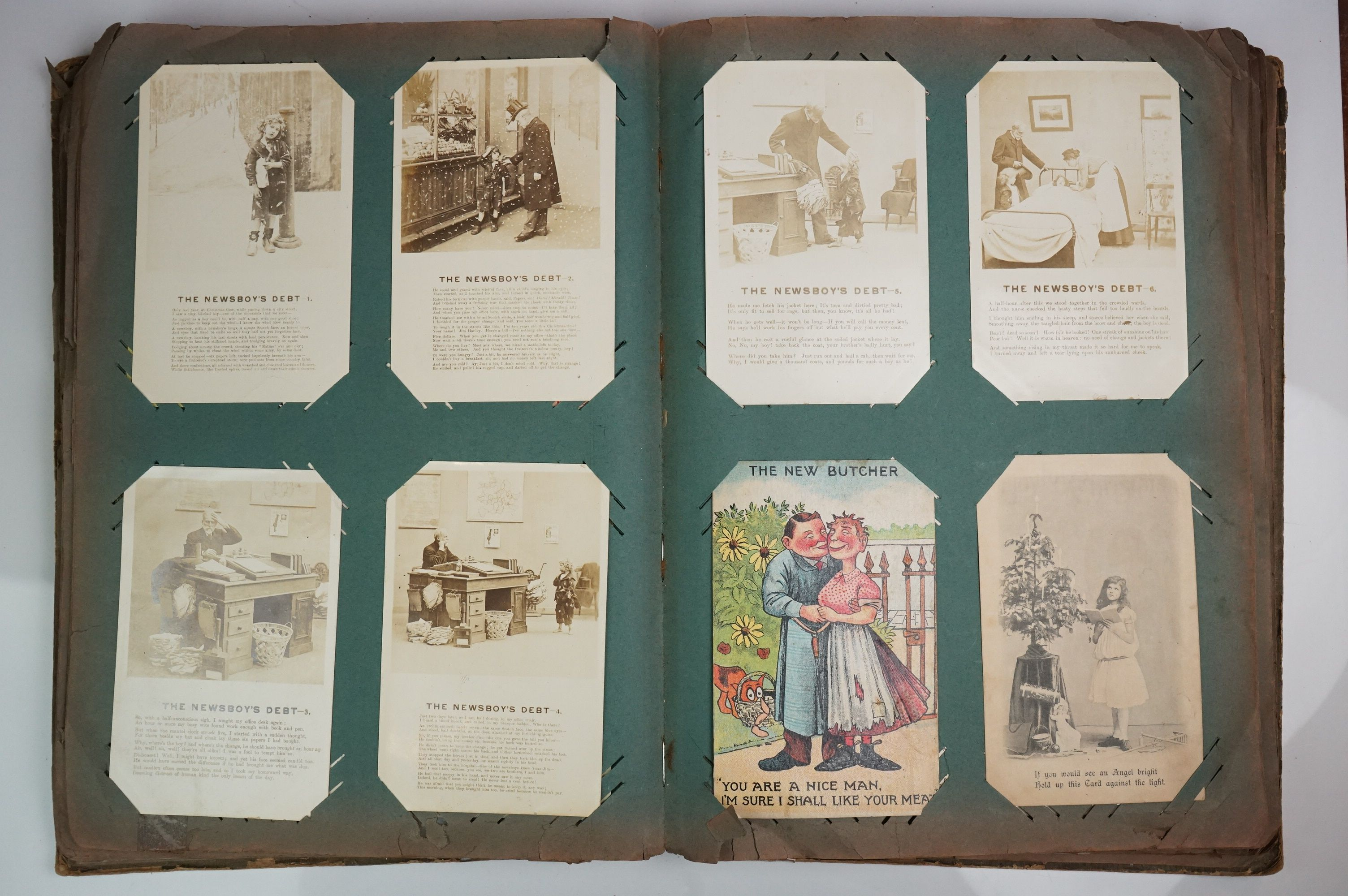A large collection of early 20th century postcards contained within an album, mainly printed - Image 2 of 11