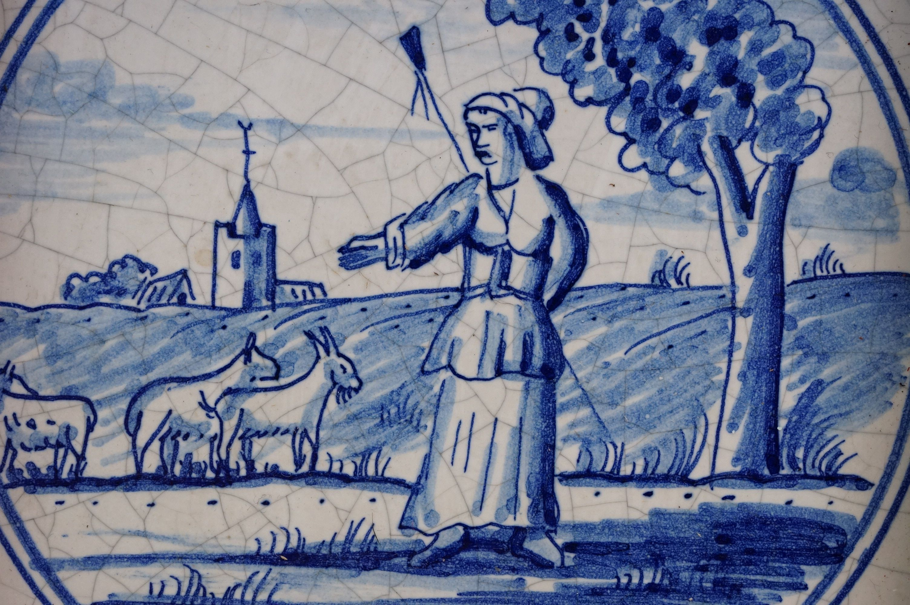 Dutch Delft-style blue and white tile depicting a shepherdess with goats, impressed dove mark to - Image 3 of 4