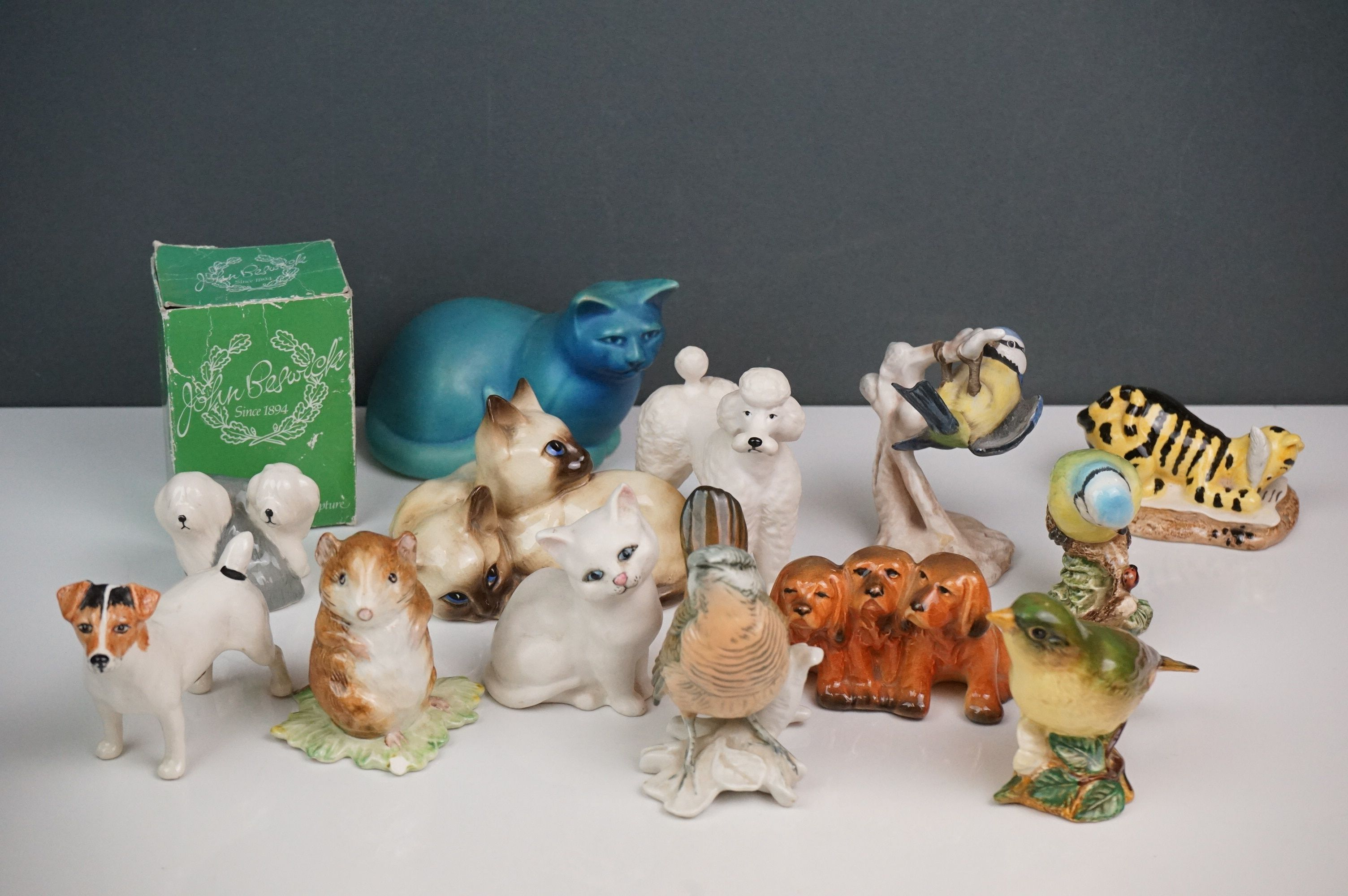 A small collection of ceramic animals to include Beswick & Royal Doulton examples.