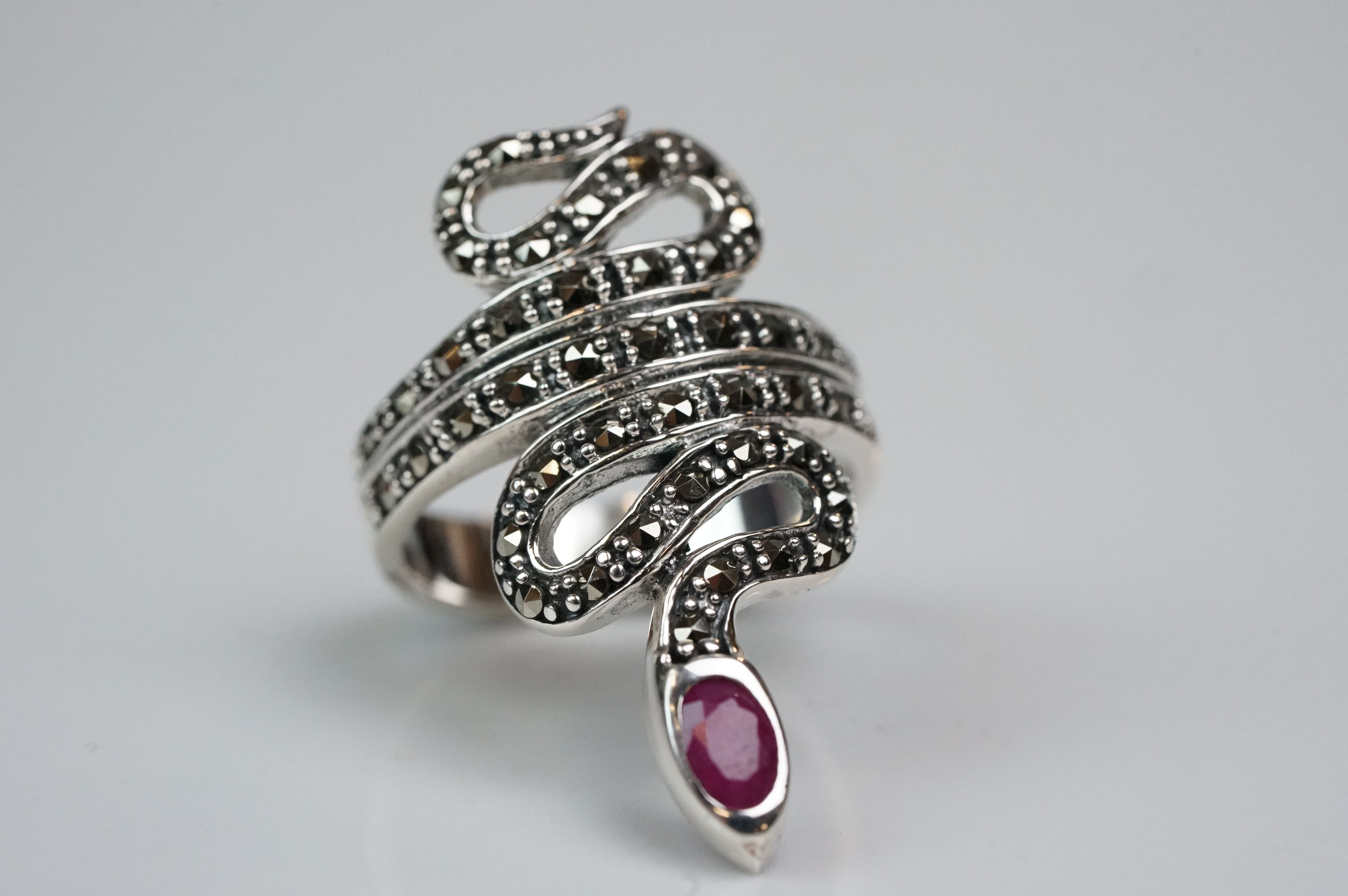 Silver dress ring in the form of a snake, set with marcasites and ruby