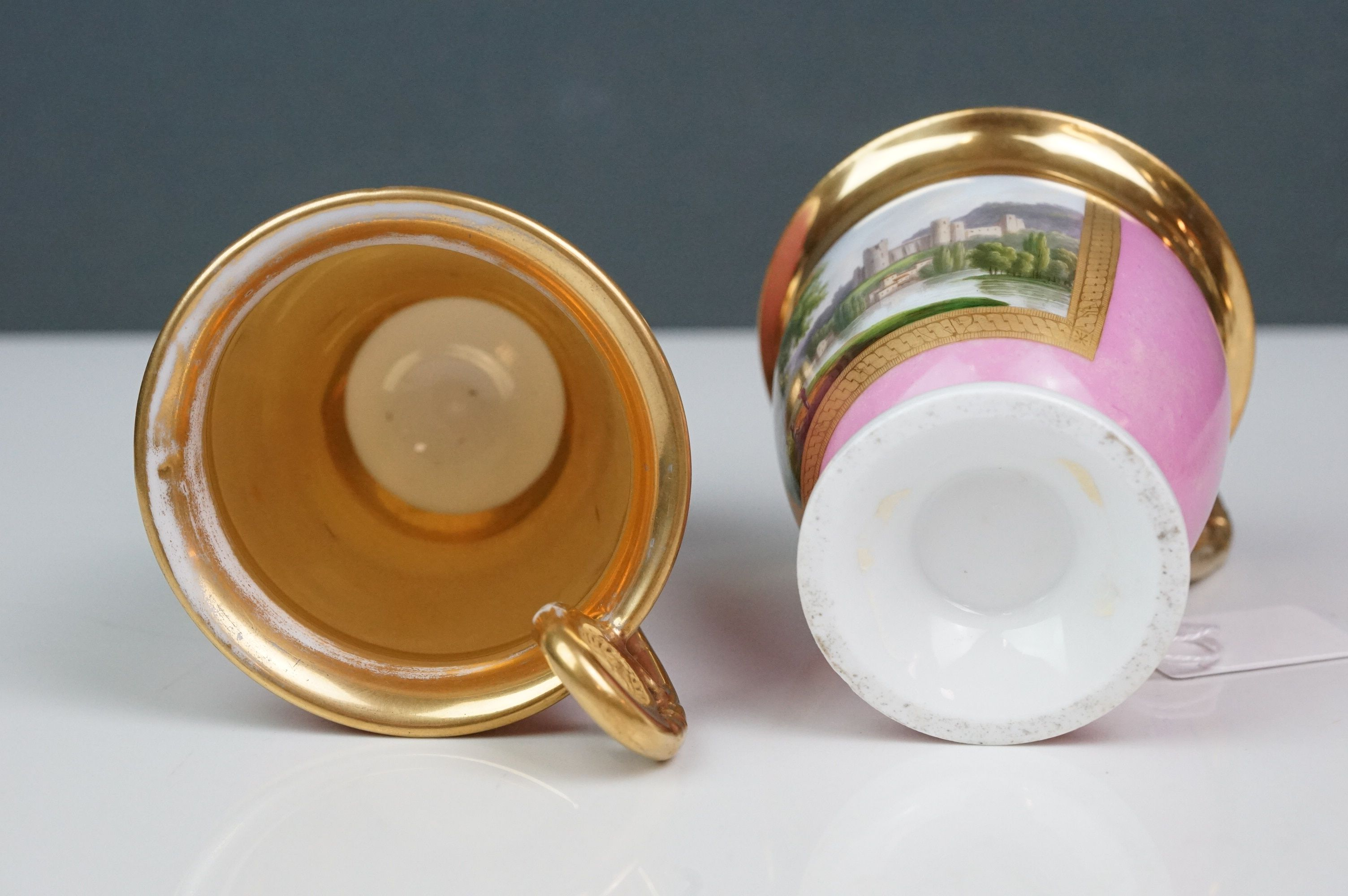 Pair of hand painted Dresden cups, each depicting a different scene: castle and lake scene with - Image 6 of 10