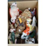 A group of collectable oriental ceramic figurines and an Asian String Puppet