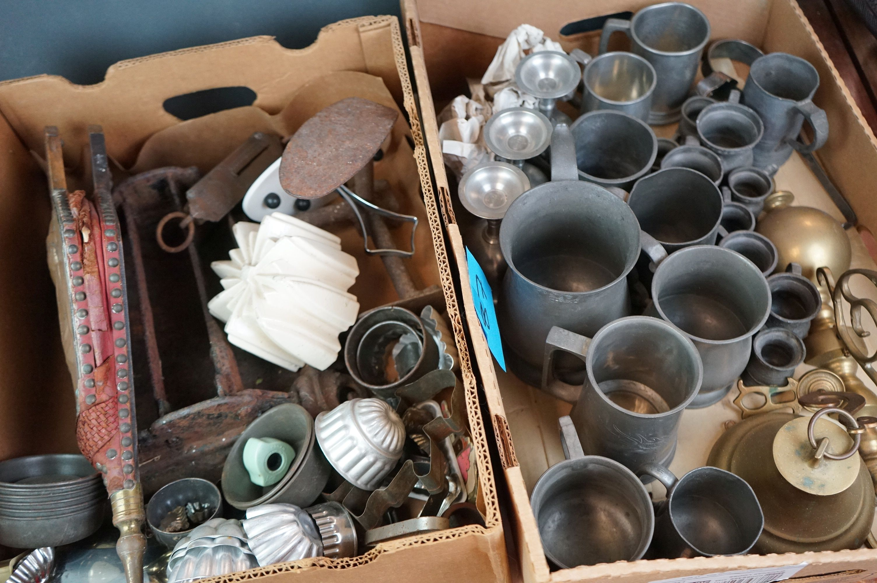 A group of mixed collectables to include a victorian cast iron boot scraper, assorted kitchenalia,