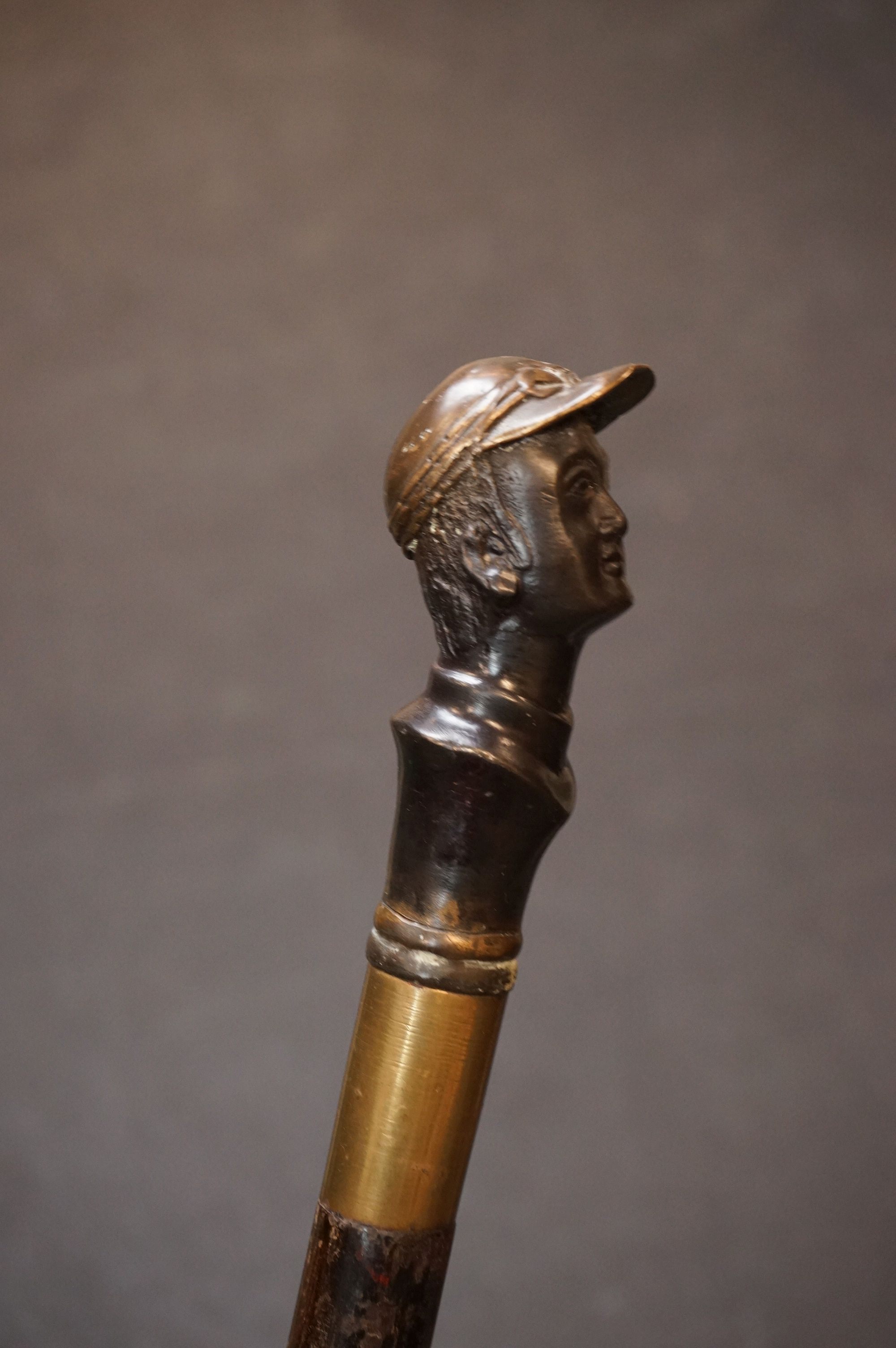 A wooden walking stick with bronzed mounted head of a jockey to the finial, possibly Fred Archer. - Image 3 of 7