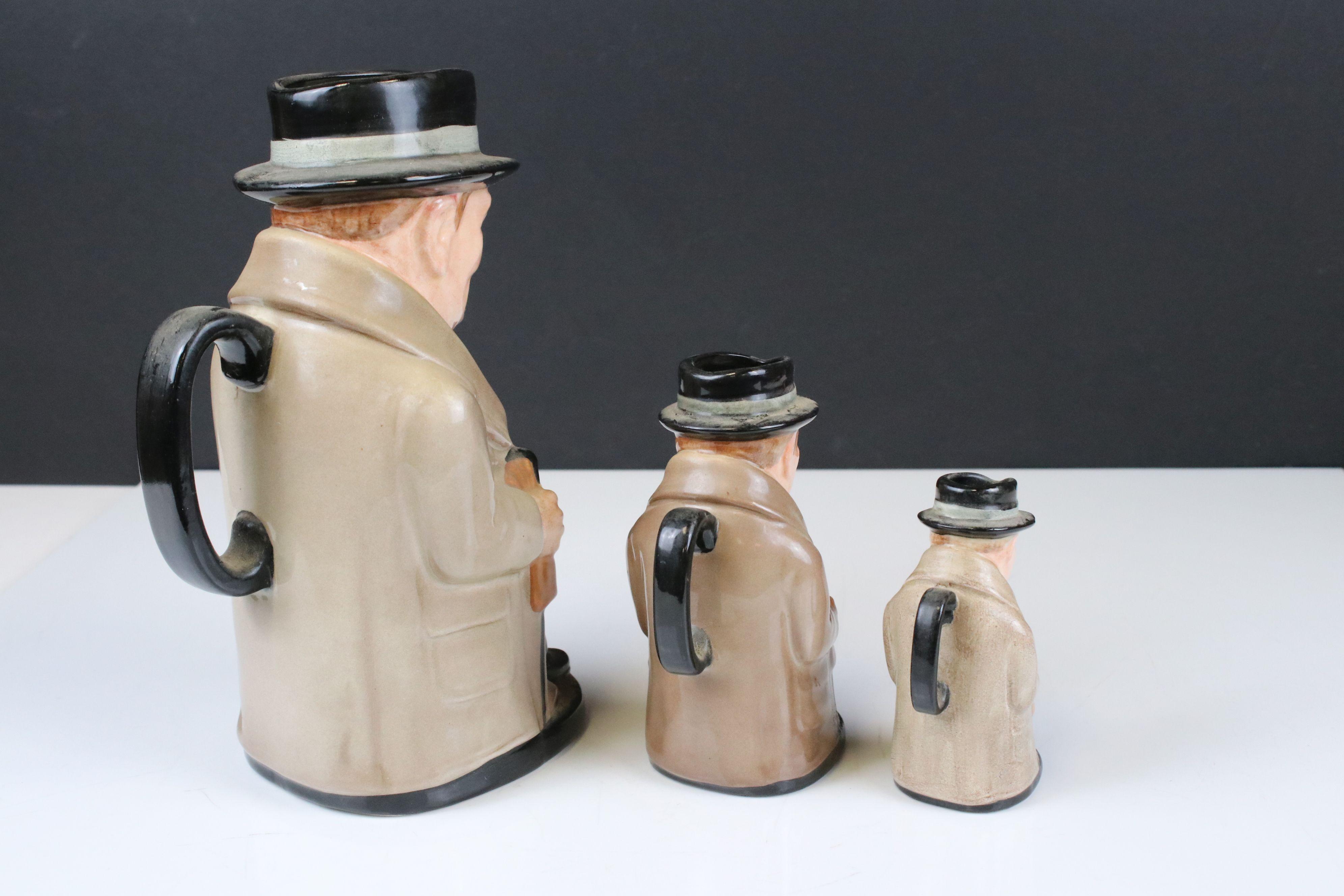 Three Royal Doulton Graduating ' Winston Churchill ' Toby Jugs, largest 23cms high - Image 5 of 5