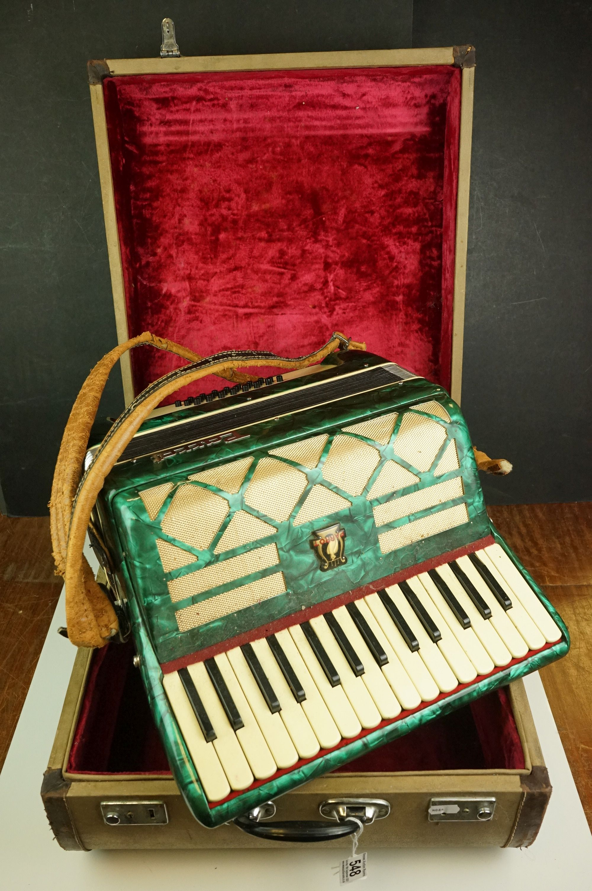 A vintage Parrot Accordion in green in original fitted case.