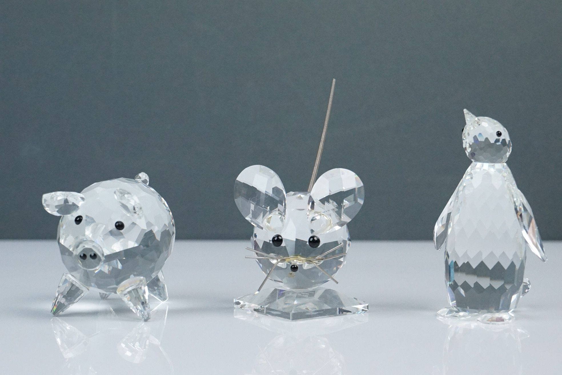 Three Swarovski crystal figurines: pig length approx 7cm, mouse and penguin height approx 8cm, (3)
