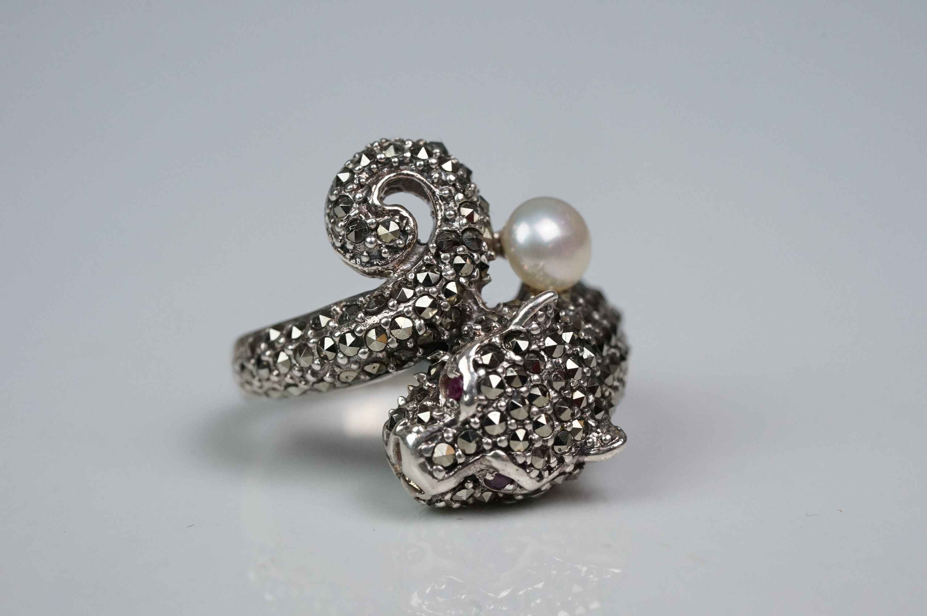 Silver panther ring, set with marcasites and ruby eyes