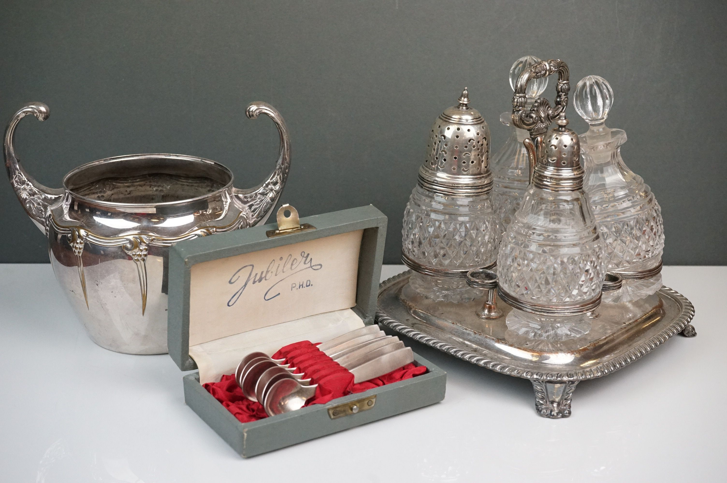 Silver plate - a Victorian four bottle cruet with cut glass bottles, WMF bowl with raised scroll