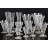 Large matched suite of Early 20th century Drinking Glasses, all with etched scrolling foliate