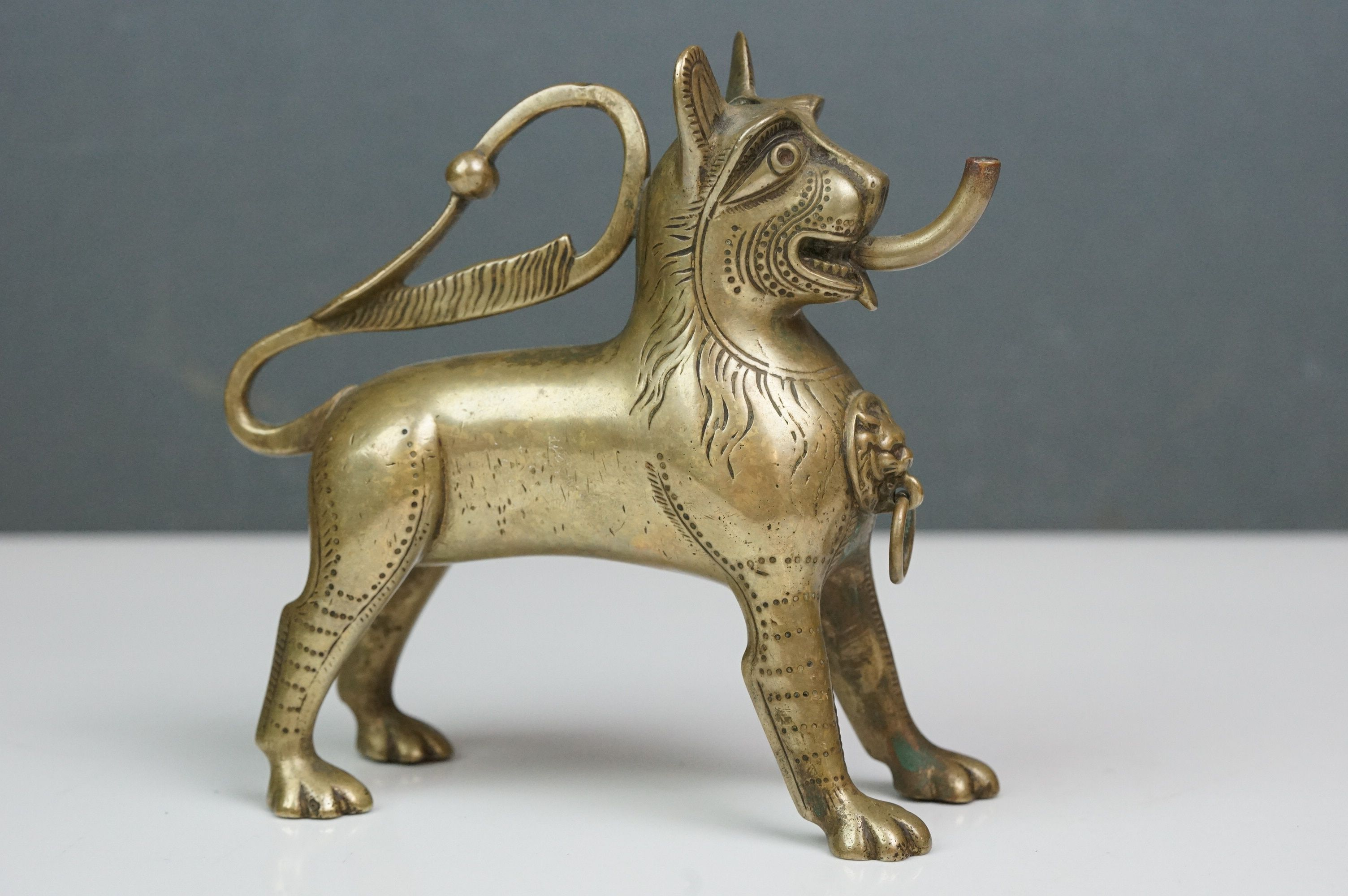 Antique brass table top cigar lighter in the form of a stylized dog