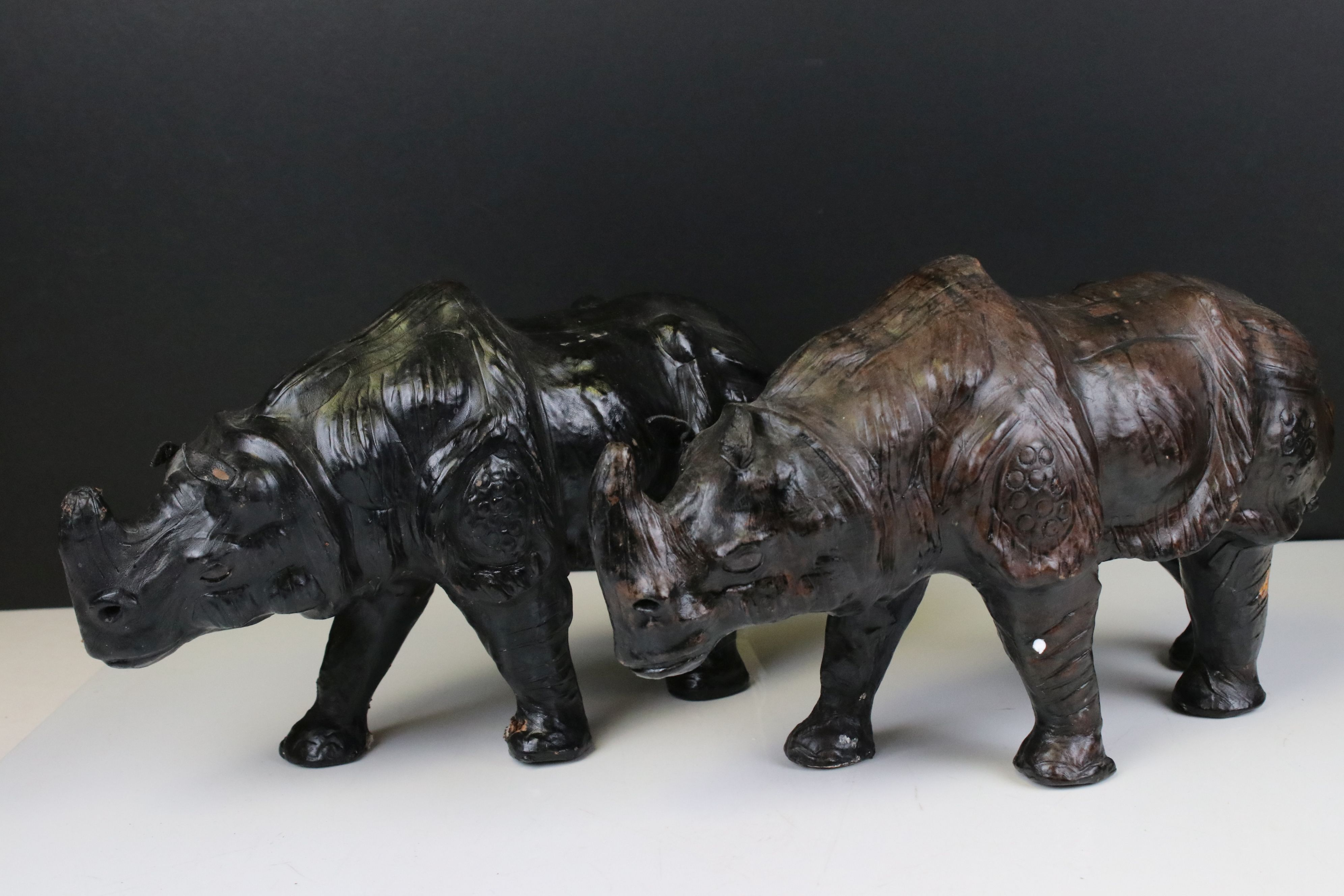 Pair of Leather covered models of Rhinoceros, 19cms high