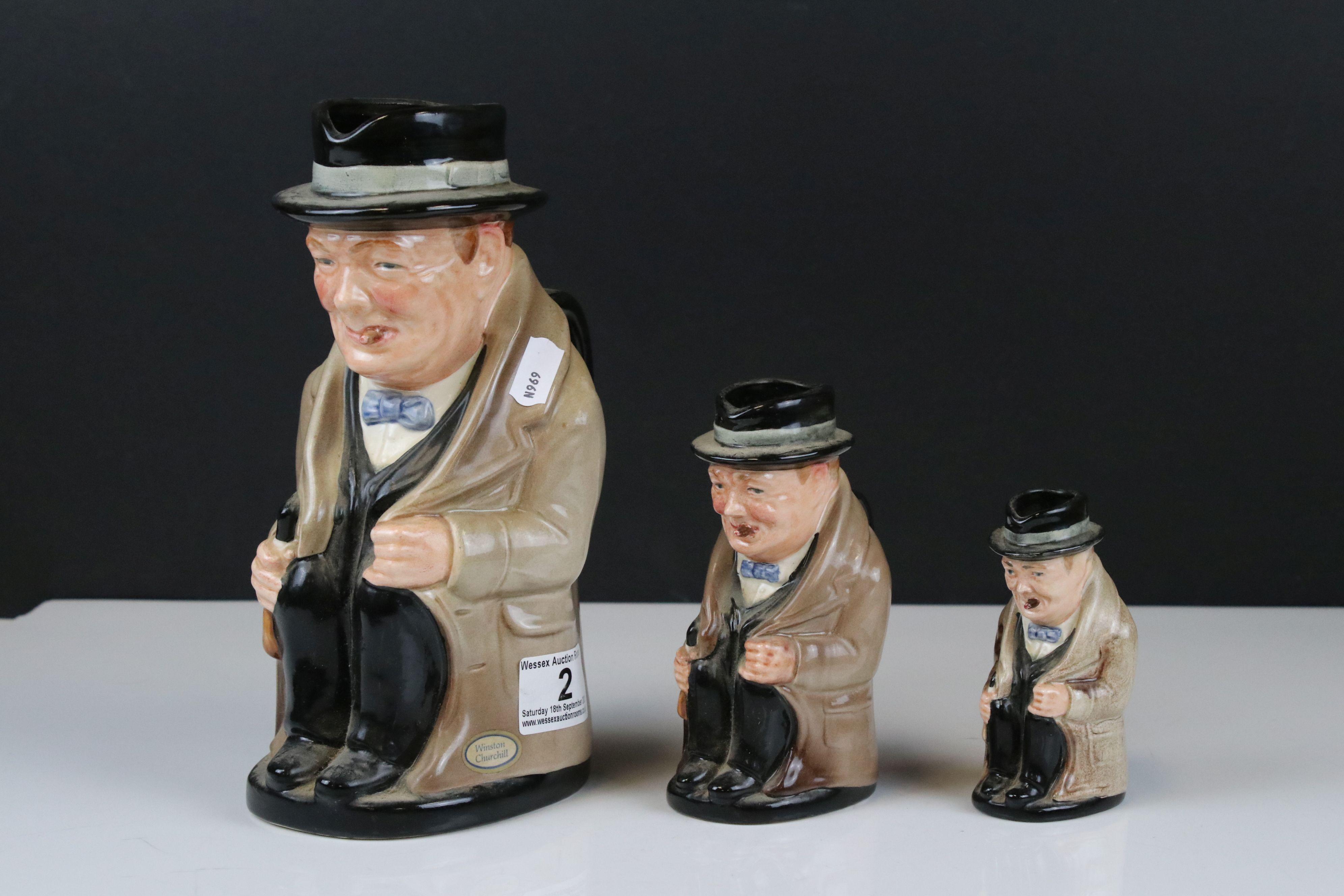 Three Royal Doulton Graduating ' Winston Churchill ' Toby Jugs, largest 23cms high