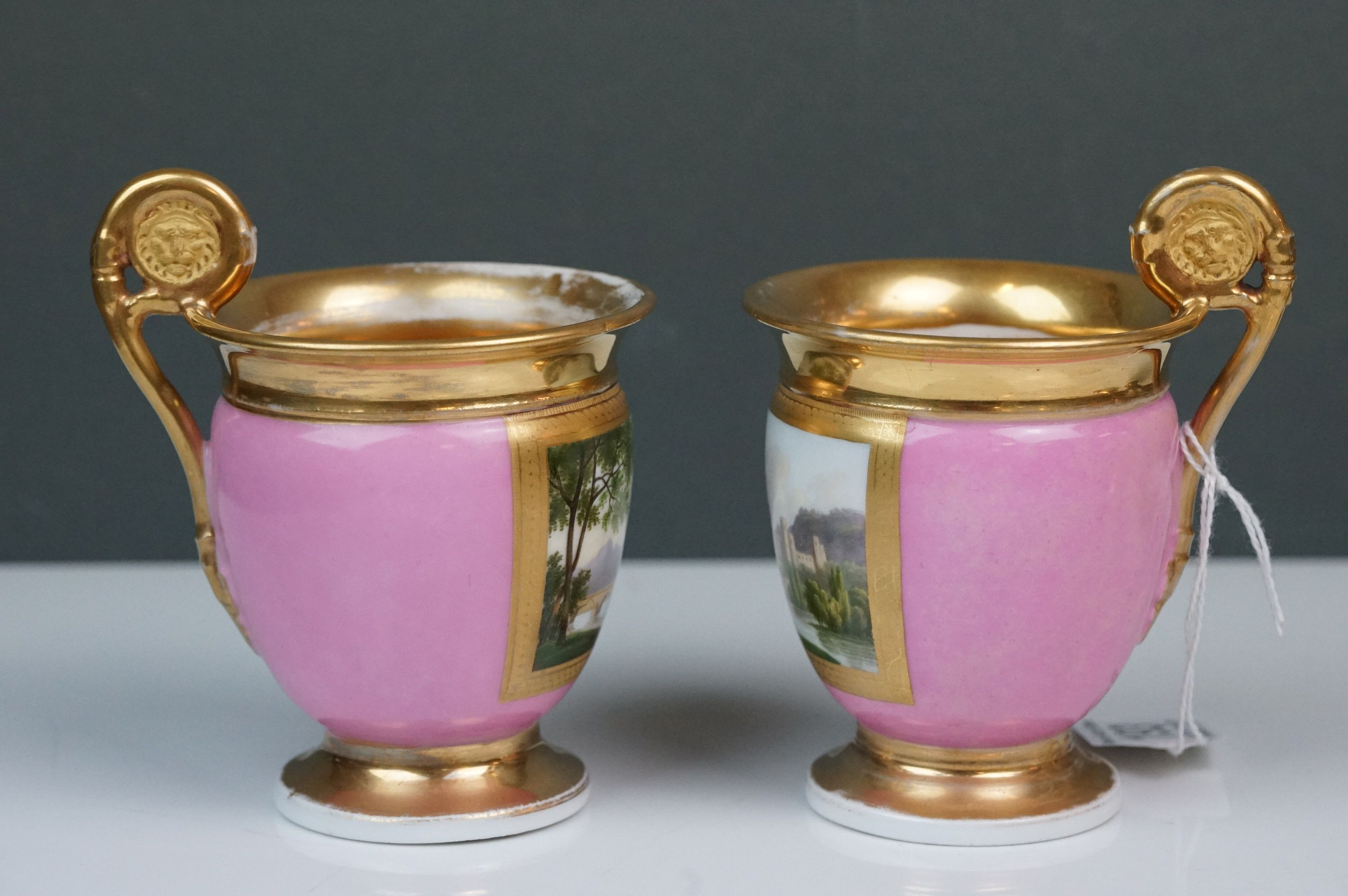Pair of hand painted Dresden cups, each depicting a different scene: castle and lake scene with - Image 4 of 10