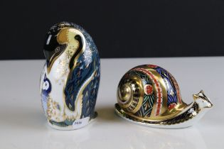 Two Royal Crown Derby Ceramic Paperweights - Penguin and Chick (gold stopper) and Garden Snail (