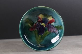 Moorcroft small Dish decorated in an Iris pattern, impressed marks to base, 11.5cms diameter