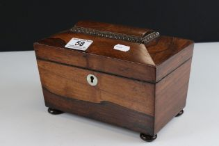 Georgian Rosewood Tea Caddy of sarcophagus form, the hinged lid opening to two lidded