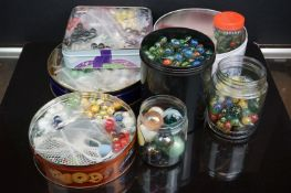 A large collection of vintage and contemporary marbles contained within various boxes.