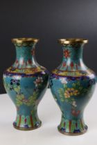 Pair of Chinese Cloisonne Vases decorated with flowers on a turquoise ground, 27cms high