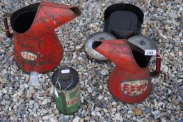 Three vintage oil advertising cans to include Esso and Castrol together with an exterior bell.
