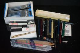 A small collection of vintage fountain pens to include a Watermans example with 14k gold nib