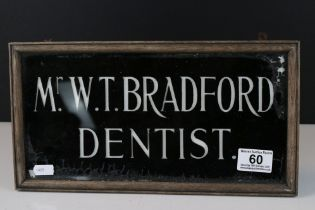 Early to Mid 20th century Glass Dentist Sign ' Mr.W.T. Bradford ' within wooden frame.