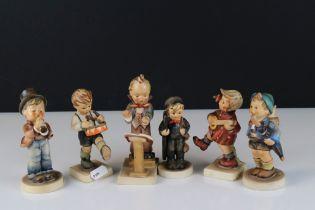 Six Goebel Hummel Figures including Chimney Sweep, Home from market, Band Leader, Serenade,