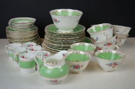 19th century Staffordshire Pottery Tea Service decorated in the New Chelsea Rose pattern with hand