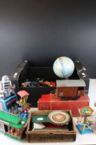 A small collection of vintage toys to include tin plate examples, die cast vehicles and a boxed